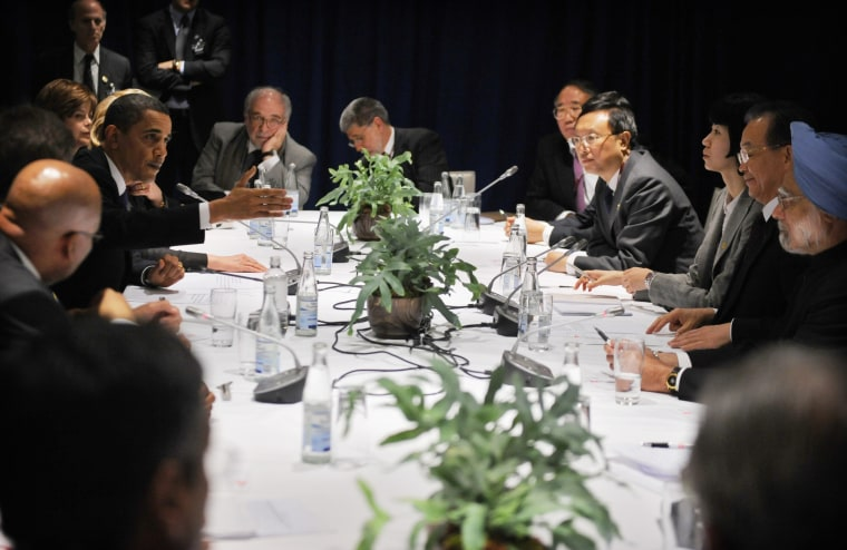 U.S. President Barack Obamaspeaks during talks Fridaywith Chinese Premier Wen Jiabao, Indian Prime Minister Manmohan Singh, both far right, and several other leaders in Copenhagen.