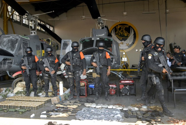Guatemalan anti-narcotics police on March 27 show weapons confiscated from what they said was a training camp run by Mexico's Los Zetas drug cartel. The group was one of three placed Wednesday on a U.S. list ofinternational drugtraffickers.