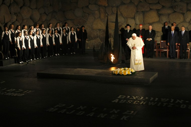 Pope Benedict XVI attends a wreath laying ceremony at the Yad Vashem Holocaust Memorial in Jerusalem on Monday.