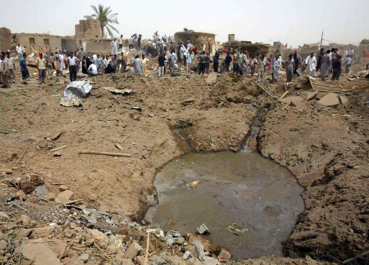 The blast outside a mosque in Taza, Iraq, on Saturday left this crater and leveled several surrounding homes.