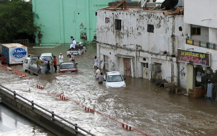 People are stranded in a flooded area in the Saudi Red Sea city of Jiddah on Wednesday.