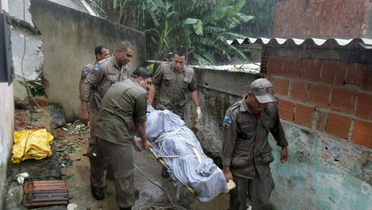 Members of a rescue team carry the corpse of a victim of a mudslide in Rio de Janeiro, Brazil, on Thursday.