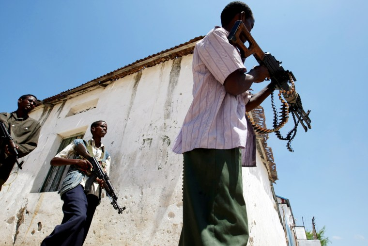Somali government soldiers engage in a shootout with Al-Shabab militants at a frontline section in Mogadishu on June 2.