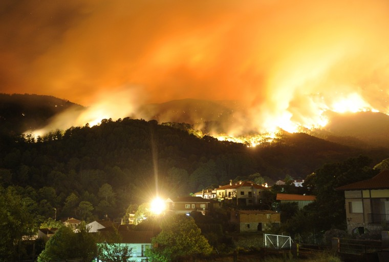 A fire rages outside Cuevas del Valle in the Spanish province of Avila early Wednesday.