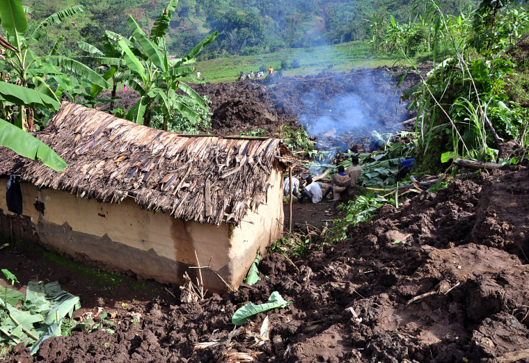 Mud from a landslide surrounds a home in Bududa, Uganda, on Wednesday.