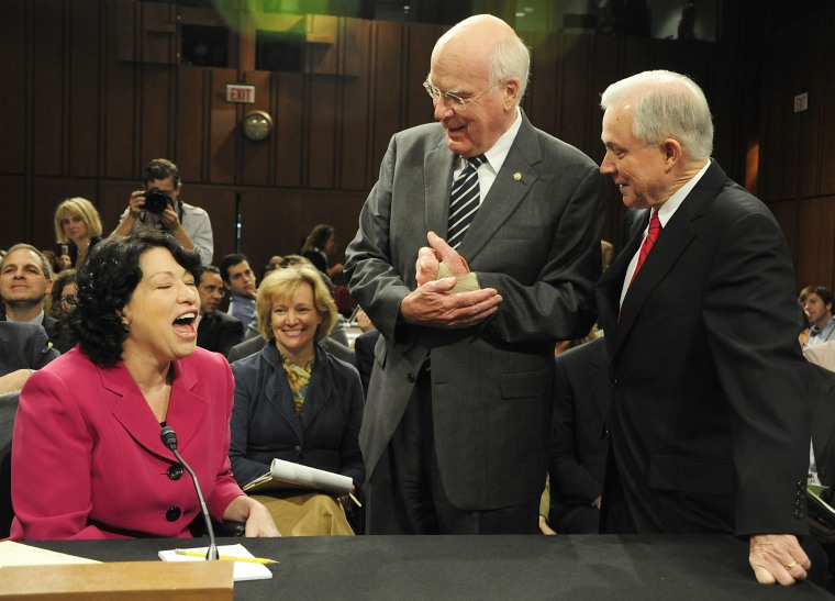 Sens. Patrick Leahy, D-Vt., and Jeff Sessions, R-Ala., talk with Supreme Court Nominee Sonia Sotomayor during her fourth day of confirmation hearings before the Senate Judiciary Committee on Capitol Hill.