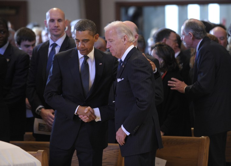 President Barack Obama and Vice President Joe Biden gather at the funeral of Jean Finnegan Biden at the Immaculate Heart of Mary Catholic Church in Wilmington, Del., on Monday.
