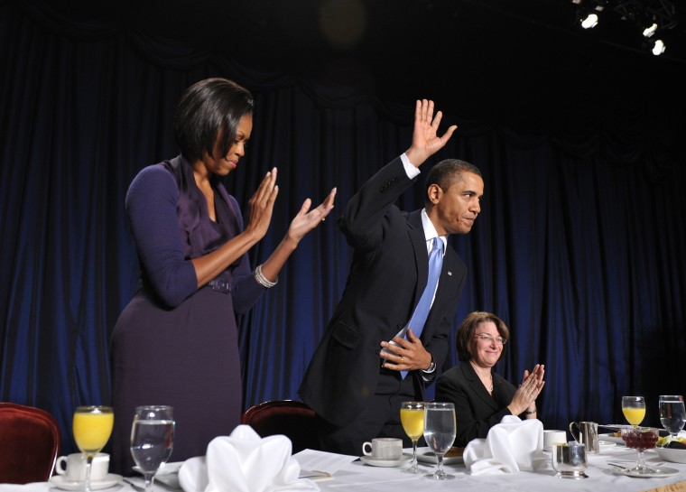 President Barack Obama acknowledges applause after speaking at the 58th National Prayer Breakfast Thursday at a hotel in Washington.