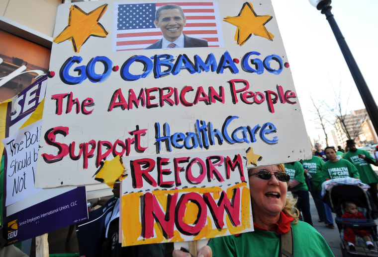 Demonstrators display placards supporting President Barack Obama's proposed health care overhaulduring a demonstration in Washington on March 9.