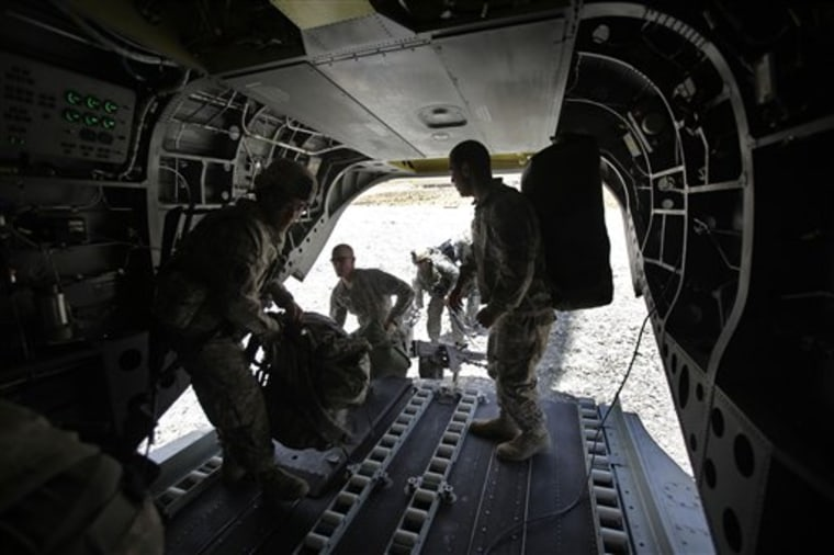 U.S. soldiers heading to a forward operating base in the Zabul province of Afghanistan load their gear Wednesday onto a Chinook helicopter.