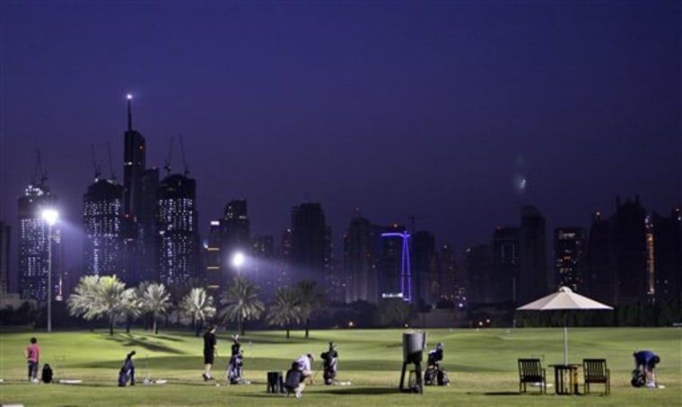 APTOPIX Dubai Financial Problems