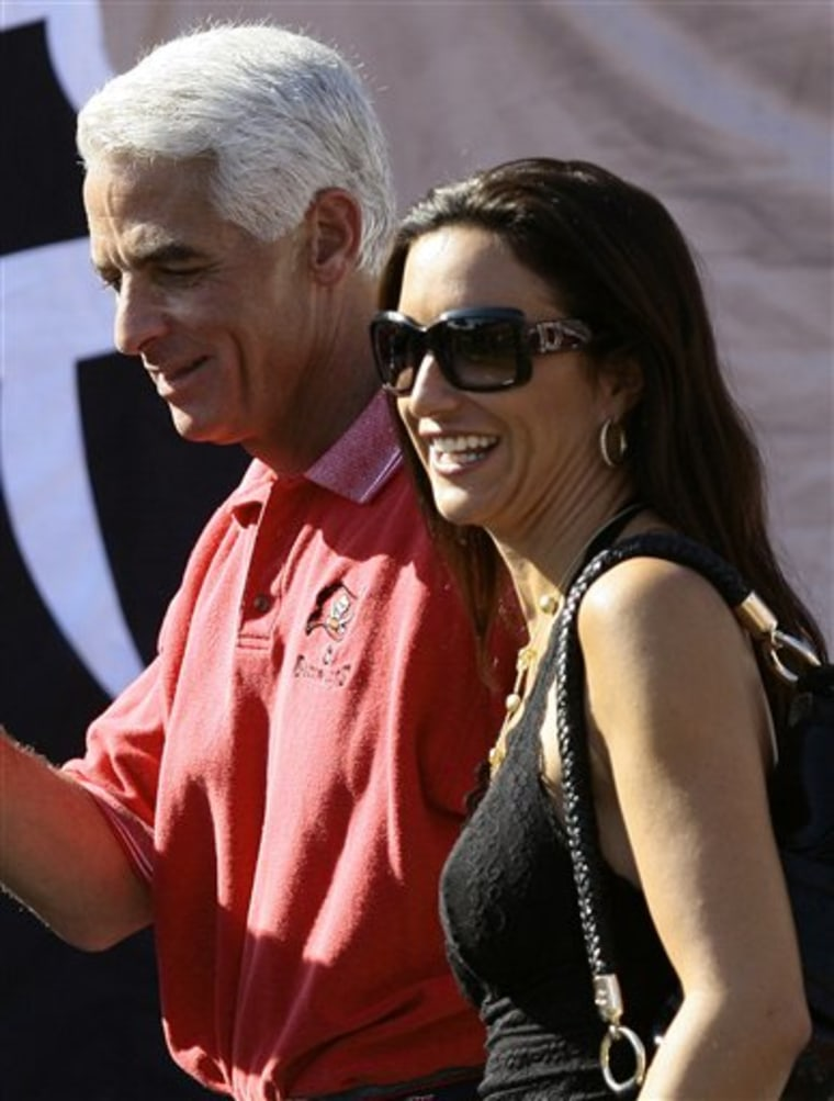 Florida Gov. Charlie Crist and Carole Rome are seen in November on the sidelines of the Washington Redskins and Tampa Bay Buccaneersfootball game.