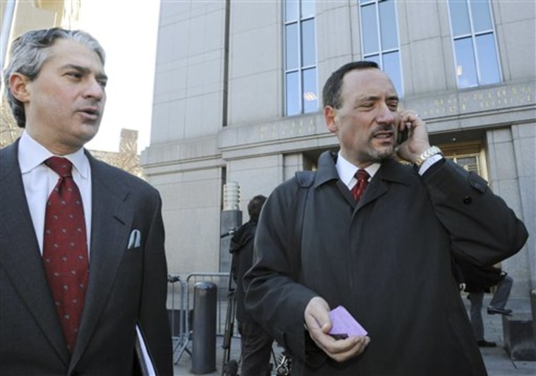 LawyersStephen Weiss, left, and Brad Friedman, who represent dozens of clients of Bernard L. Madoff, arrive at Manhattan federal court on Friday in New York.
