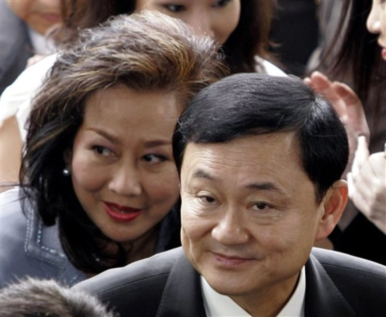 Thaksin Shinawatra and his wife Pojaman at a Bangkok court in July 31.
