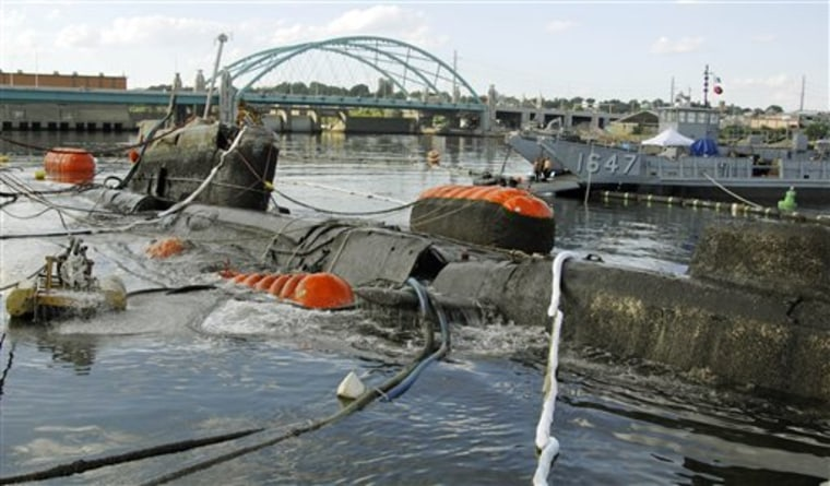 The former Soviet submarine Juliett 484 comes to the surface of the Providence River in Providence, R.I., on Friday.