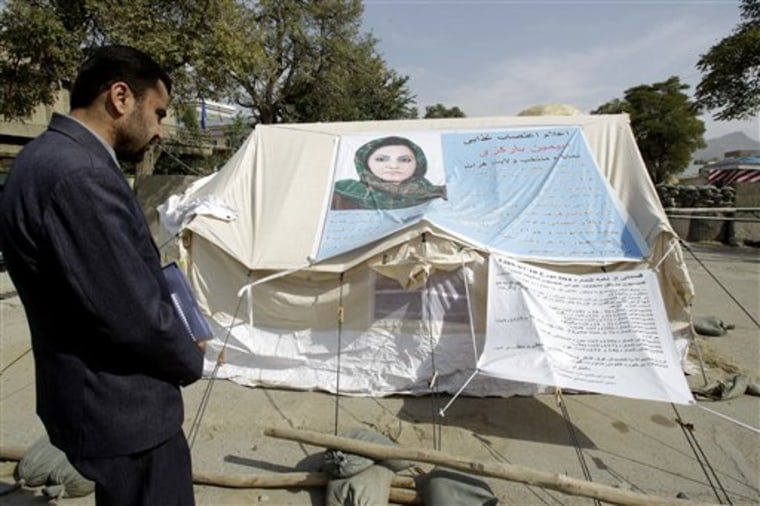 A man visits the tent of Afghan lawmaker from western Herat province, Simeen Barakzai, as she continued her fast for the eighth consecutive day in Kabul, Afghanistan, Sunday Oct. 9. Barakzai, 32, decided to go on hunger strike after she was unseated by the Independent Election Commission (IEC) in August.