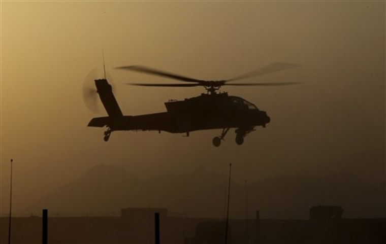 AU.S. Army Apache attack helicopter takes off after refueling during a several-hour firefight against the Taliban, in Zhari district, Kandahar province, southern Afghanistan, late Friday, Aug. 20.