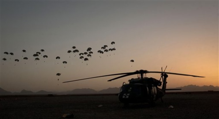 Food supplies for US Marines hanging off small parachutes are dropped from a plane outside Forward Operating Base Edi in the Helmand Province of southern Afghanistan, on Monday.