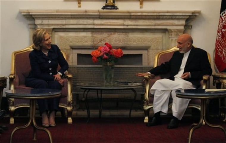 Afghan President Hamid Karzai, right, speaks with the U.S. Secretary of State Hillary Clinton at the presidential palace in Kabul Afghanistan on Monday ahead of the International Conference on Afghanistan.