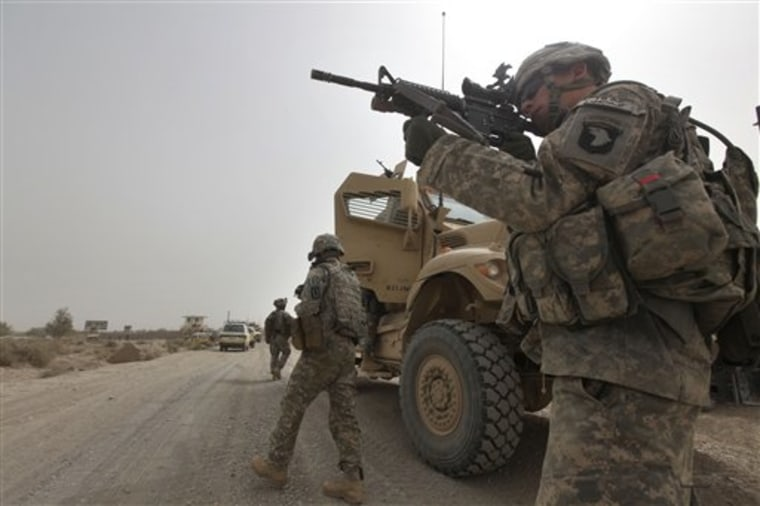 U.S. Army Spc. Cody Borawa, of Unadilla, N.Y., of Tactical Command Post, HQ Company, 2-502 Infantry, 101st Airborne Division, looks for a Taliban position, during a day of joint missions with the Afghan Army, in Zhari district, Kandahar province, southern Afghanistan, on Aug.26.