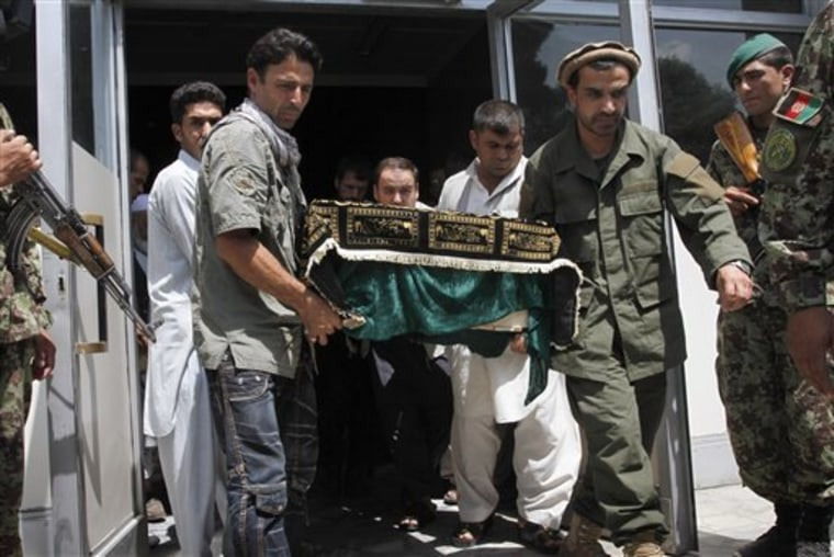 Relatives carry the body of one of two Afghans killed with members of a medical team in northern Afghanistan a few days ago,from the morgue at a hospital in Kabul on Monday.