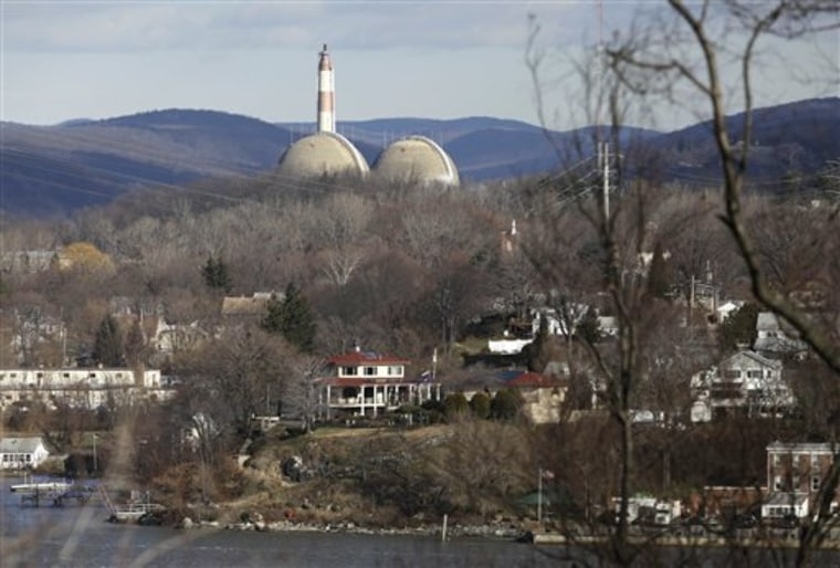 Reactor containment domes of the Indian Point nuclear power plant in Buchanan, N.Y., rise above homes just north of Verplanck.