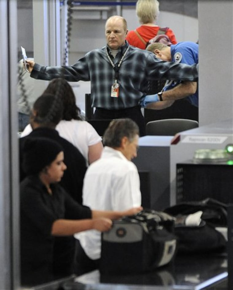 An air traveler is patted down by a TSA agent Monday at O'Hare International Airport in Chicago.