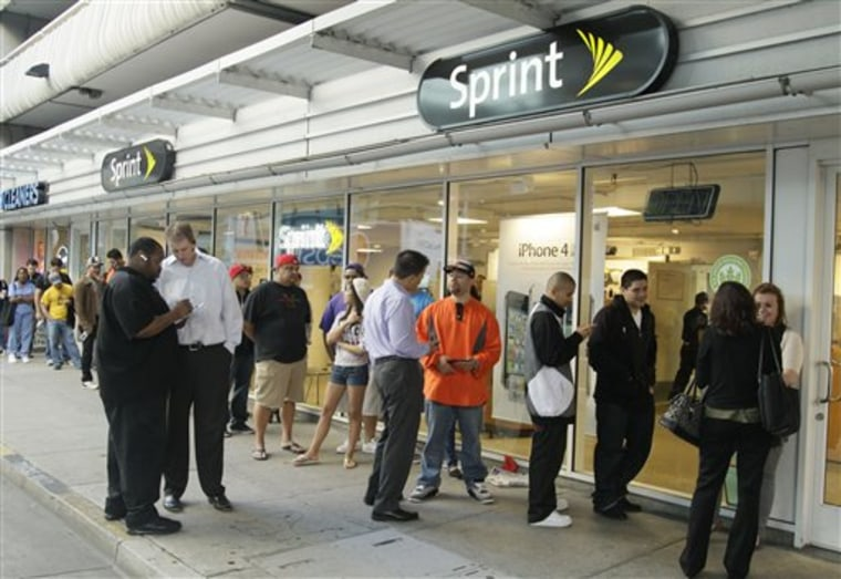 A line of people, wanting to purchase the new Apple iPhone 4S, wait in line for a Sprint store to open in San Francisco, Friday, Oct. 14, 2011.