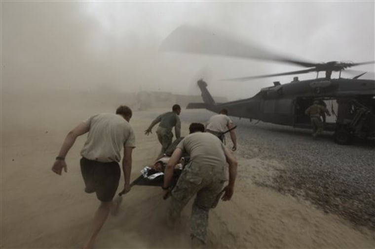 During a rescue mission by a team from a U.S. Air Force Expeditionary Rescue Squadron, army medics carry a wounded Afghan Army soldier to an evacuation helicopter, in Kandahar province, southern Afghanistan on Monday.