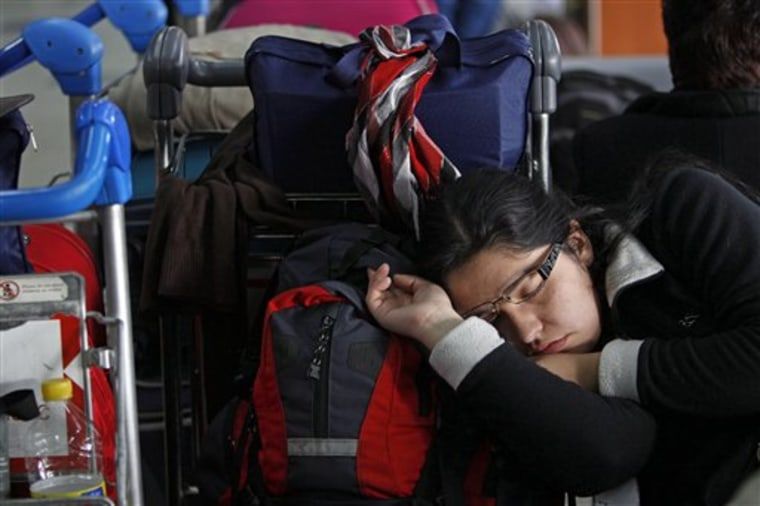 A girl sleeps at Jorge Newbery airport where flights were canceled due to an ash cloud that reached Buenos Aires from the Chilean Puyehue-Cordon Caulle volcano grounding air travel in Buenos Aires, Argentina.