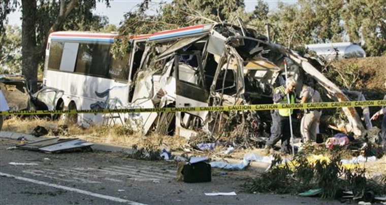 California Highway Patrol officers investigate a Greyhound bus crash on Highway 99 in Fresno, Calif., that killed six people.