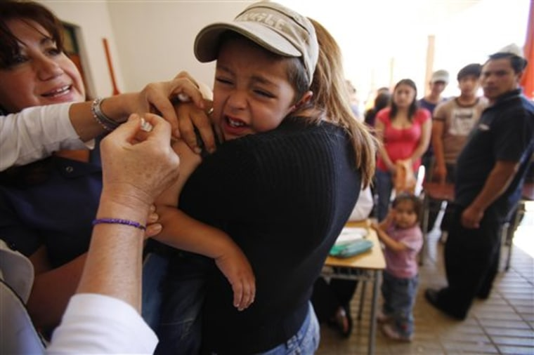 A boy is vaccinated in Constitucion, Chile, on Friday.