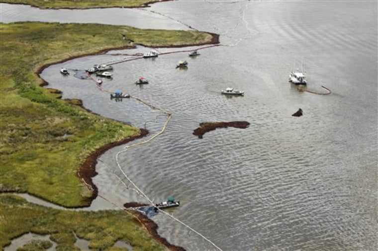 Boats are seen along the oil damaged shoreline in the northern reaches of Barataria Bay, La., on Thursday.