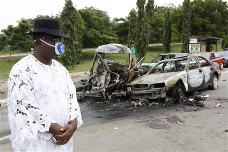 Two car bombs blew up on Friday as Nigeria celebrated its 50th independence anniversary, killing a number of people in an unprecedented attack on the capital by suspected militants from the country's oil region.