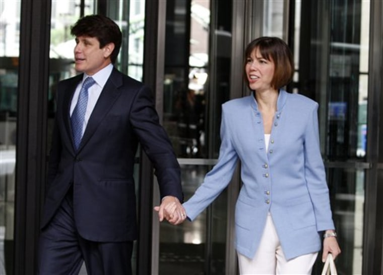 Rod Blagojevich and his wife Patti leave the Dirksen U.S. Courthouse, downtown Chicago, on Monday. A federal judge refused the defense's request to delay Blagojevich's corruption trial today.