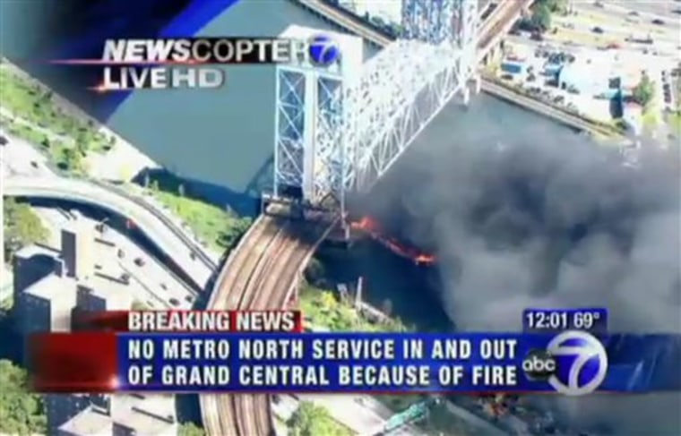 This frame capture from video released by WABC-TV in New York shows fire and smoke beneath the 138th Street lift bridge on the Harlem River on Monday.
