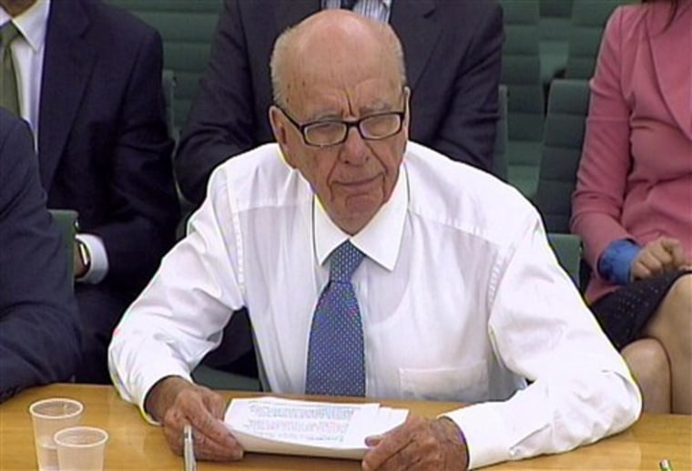 "Asked whether he was considering resigning as head of News Corp., Rupert Murdoch said: ""No."""