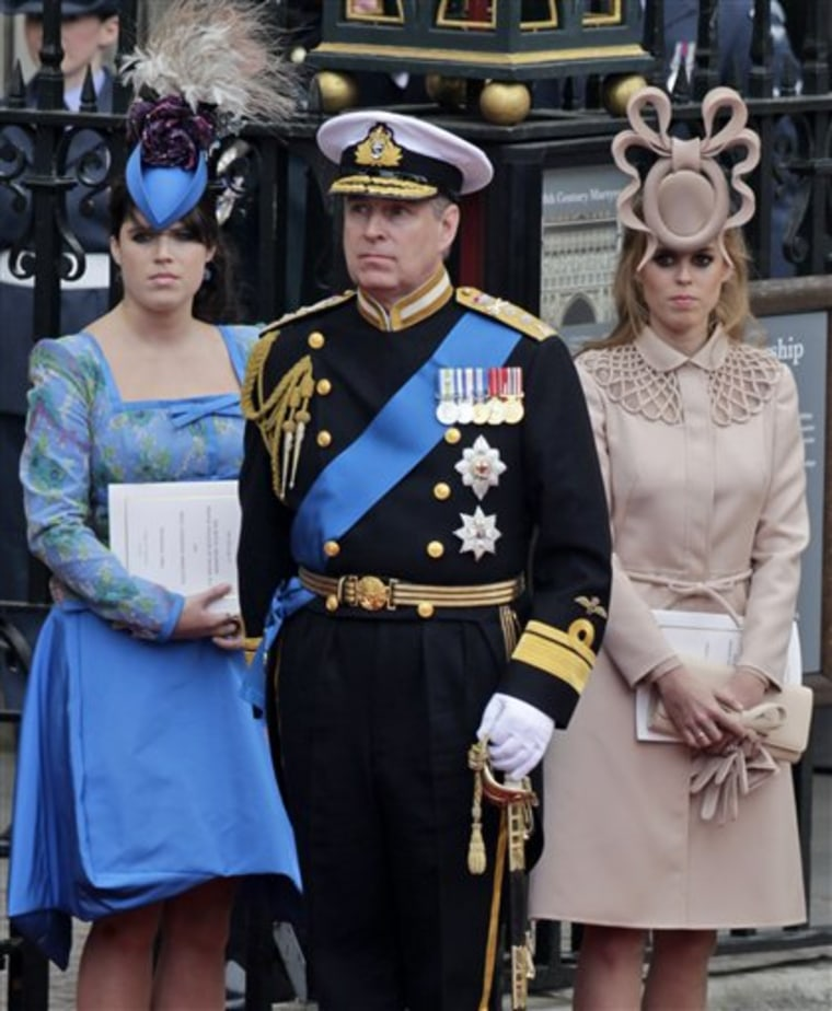 Britain's Prince Andrew, center, and his daughters Princess Eugenie, left, and Princess Beatrice leave Westminster Abbey at the royal wedding in London on April 29.