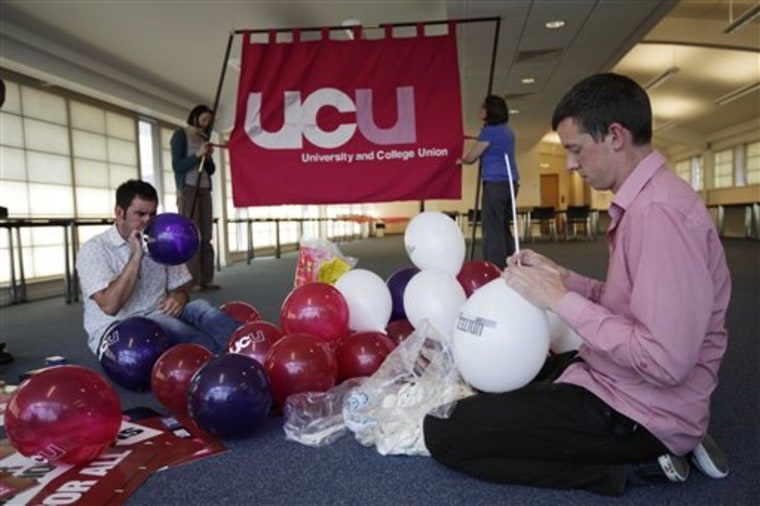 Members of Britain's University and College Union (UCU) prepare for a union strike and march scheduled for Thursday.