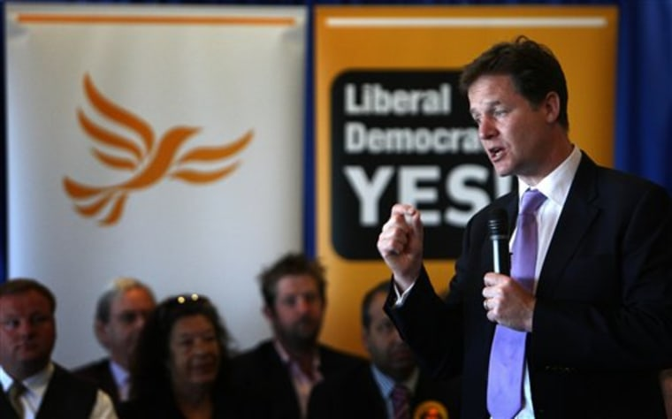 Britain's Deputy Prime Minister Nick Clegg answers questions about the proposed new voting system at the Walker's Stadium, Leicester, Wednesday.