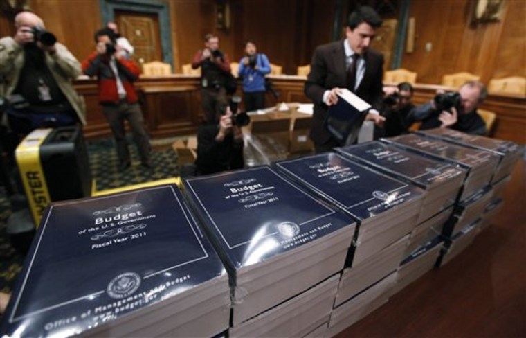 Copies of President Barack Obama's budget are delivered to the Senate Budget Committee on Capitol Hill in Washington on Monday.