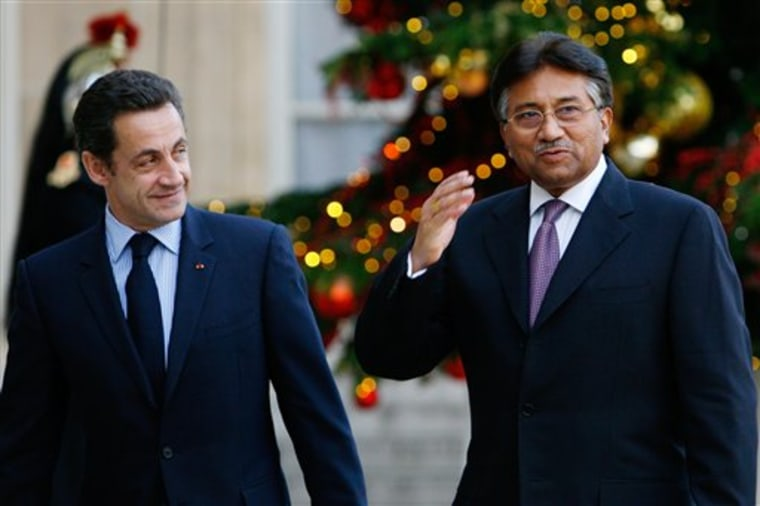 Pakistani President Pervez Musharraf, right, arrives for talks with French President Nicolas Sarkozy, left, at the Elysee palace onTuesday in Paris. Musharraf is on a eight-day European tour.