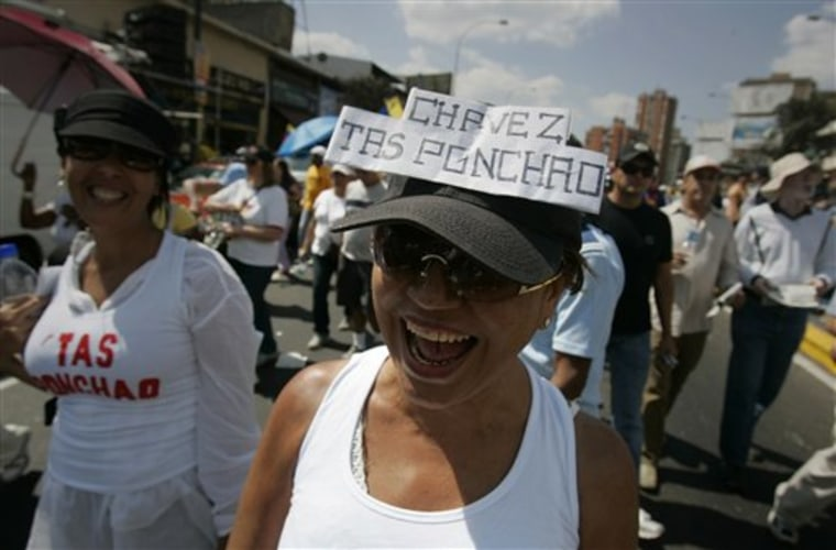 "An anti-government protester in Caracas, Venezuela, wears a cap that reads ""Chavez you're struck out"" during a march on Jan. 23."