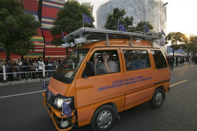 One of two driverless vehicles, equipped with laser scanners and cameras to detect and help avoid obstacles, travels on the Shanghai Expo site to attend the official celebration of their arrival in Shanghai.