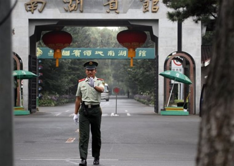 A Chinese paramilitary police man gestures for a photographer to stop shooting pictures outside the Nan Hu hotel where North Korean leader Kim Jong Il is believed to be staying after he arrived at Changchun in northeastern China's Jilin province on Friday.