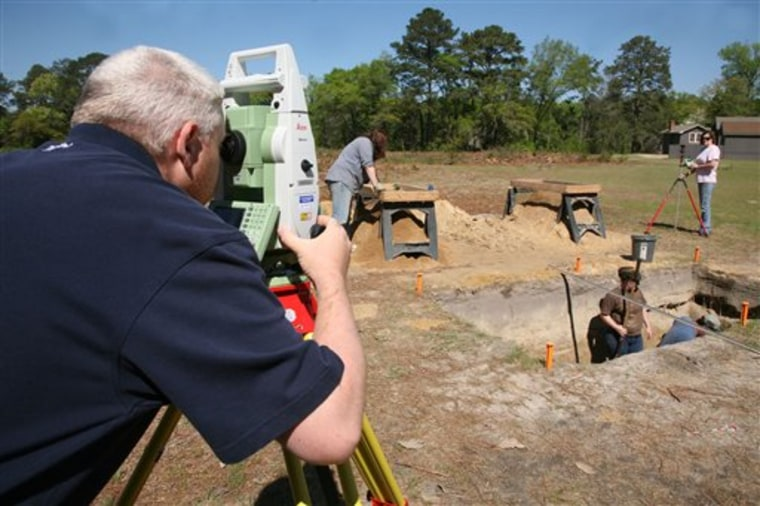 In an undated photo provided by Georgia Southern University, graduate student Kevin Chapman surveys the site at Camp Lawton while students dig in a trench in search of artifacts.