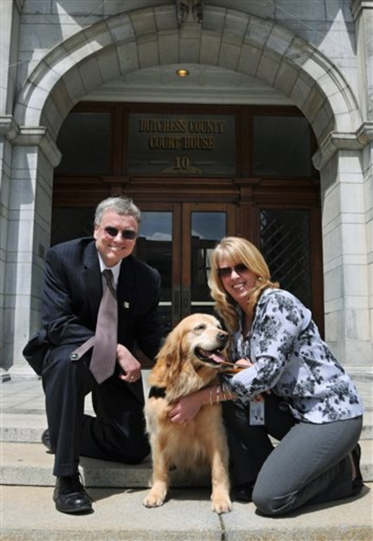 Rose, an 11-year-old golden retriever, was used in court on Monday to help calm a victim so that she could testify. With here are David Crenshaw, the clinical director of the Children's Home of Poughkeepsie, and Sherri Cookinham, Rose's handler.