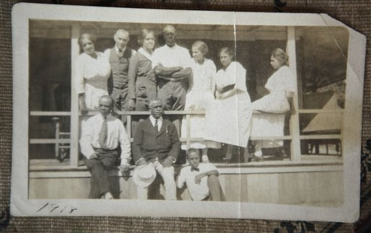 In this 1918 photo provided by Lee Jackson Van Allen, singer composer, and soloist singer Harry T. Burleigh, holding hat, below second from left, and Charles H. Shearer, top row second from left, founder of Shearer Cottage, who was born a slave in 1854, appear with family and friends at the inn in Oak Bluffs, on the island of Martha's Vineyard, Mass.