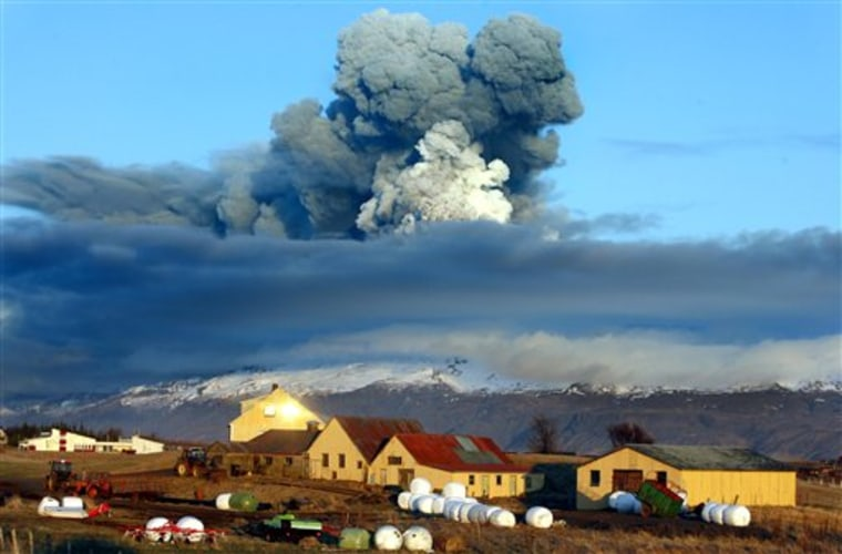 The volcano in southern Iceland's Eyjafjallajokull glacier sends ash into the air just prior to sunset, on April 16. The ash from the volcano paralyzed air traffic for days in Europe, disrupting travel for more than 7 million people.