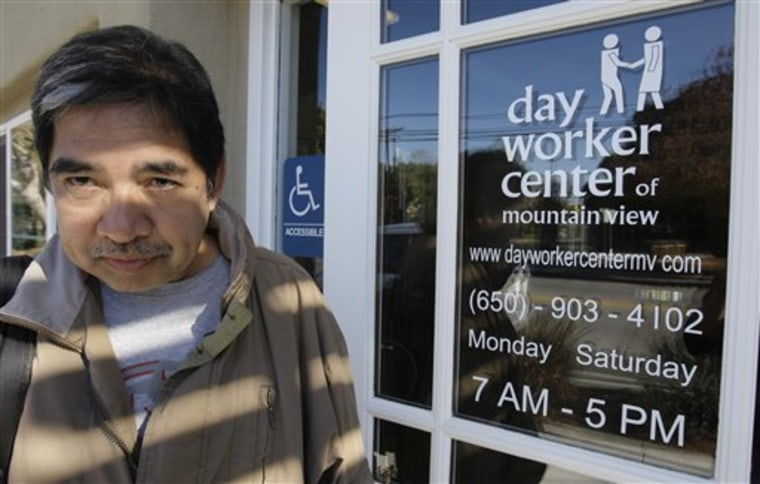 In this photo taken Tuesday, Feb. 1, 2011, job seeker Rolando Cunanan leaves the Day Worker Center of Mountain View without work in Mountain View, Calif. The number of people applying for unemployment benefits plunged last week to the lowest level in nearly three years.